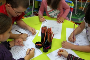 kids in a school writing activity